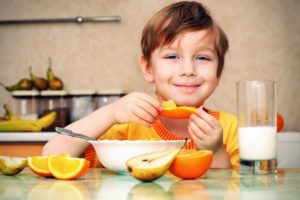 Boy-Eating-Orange-and-Pear