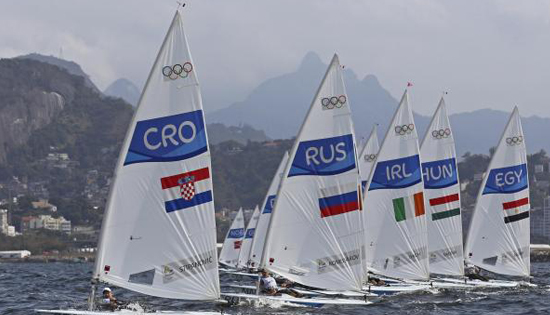 Tonci Stipanovic (CRO) of Croatia, Sergey Komissarov (RUS) of Russia, Finn Lynch (IRL) of Ireland, Benjamin Vadnai (HUN) of Hungary and Ahmed Ragab (EGY) of Egypt compete during the first Sailing race. (REUTERS)