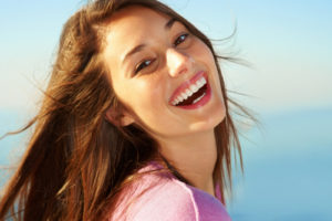 woman-laughing-and-smiling